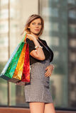 Happy young fashion woman with shopping bags at the mall Stock Images