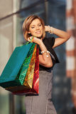Happy young fashion woman with shopping bags at the mall Royalty Free Stock Photos