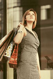 Happy young fashion woman with shopping bags in the mall Royalty Free Stock Photos