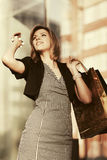 Happy young fashion woman with shopping bags in the mall Royalty Free Stock Photography