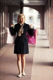 Happy young fashion woman with shopping bags Royalty Free Stock Photos