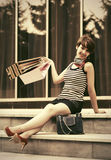Happy young fashion woman with shopping bags on the steps Stock Photo
