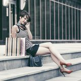 Happy young fashion woman with shopping bags talking on cell phone Royalty Free Stock Images