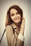 Happy young fashion woman standing at the wall Royalty Free Stock Photo