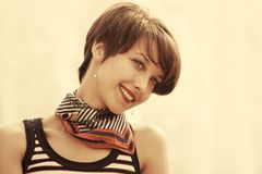 Happy young fashion woman in tank top and silk scarf outdoor royalty free stock photo