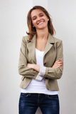 Happy young fashion woman at the wall Stock Photo