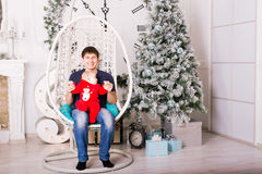 Happy young father and baby near Christmas tree Stock Images