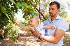 Happy young father with child spending time outdoor on a summer Stock Photo