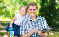 Happy young father with daughter in summer park Stock Photo