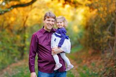 Happy young father having fun cute toddler daughter, family portrait together. man with beautiful baby girl in nature royalty free stock photo