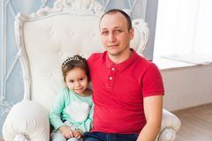 Happy young father with his daughter stock image