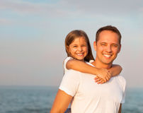 Happy young father and his daughter playing on the beach Stock Image