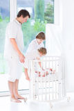 Happy young father with his tree kids Stock Image