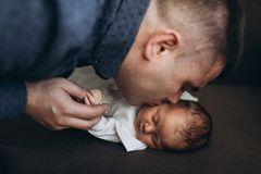 Father kisses her little babygirl. Happy and young father kiss his cutie small babygirl Royalty Free Stock Photo