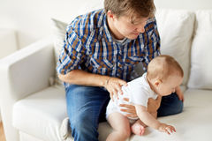 Happy young father with little baby at home Stock Images