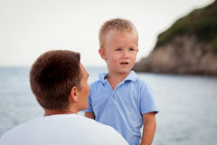 Happy young father with little son outdoors Stock Images