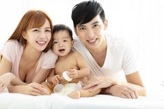 young father and mother with baby royalty free stock photo