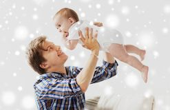 Happy young father playing with baby at home Royalty Free Stock Image