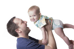 Happy young father playing with little daughter stock photo