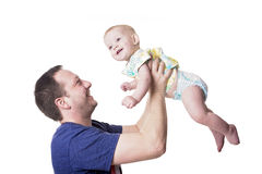 Happy young father playing with little daughter stock photos
