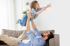 Happy young father playing with little son at home Royalty Free Stock Image