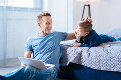 Happy young father ruffling his sons hair Royalty Free Stock Images
