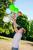 Happy young father tossing his daughter Stock Photo