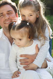 Happy young father with two little daughters Royalty Free Stock Photography
