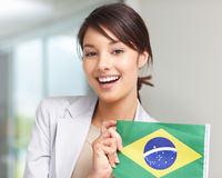 Happy young female with a Brazilian flag Stock Image