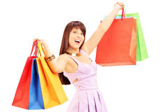 Happy young female in dress holding shopping bags Stock Images