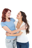 Happy young female embracing her friend Royalty Free Stock Photo