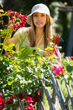 Happy young female florists in apron working Stock Images