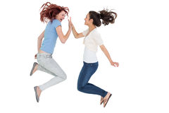 Happy young female friends playing clapping game Royalty Free Stock Photo