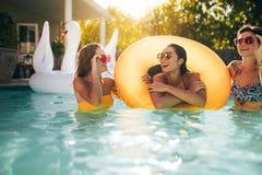 Smiling women enjoying in a pool stock photo