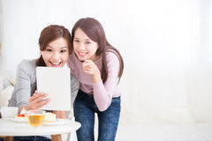 Happy young female friends stock photo