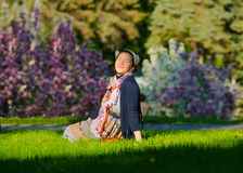 Relaxing young female on the grass Royalty Free Stock Photos