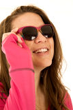 Happy young female model sporting pink sunglasses. Looking up Royalty Free Stock Photography