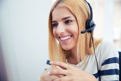 Happy young female operator in headphones Stock Image
