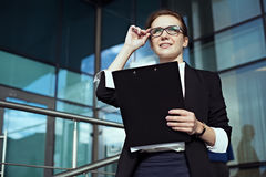 Happy young female professional manager watching in the successful future. Royalty Free Stock Photo