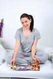 Happy young female readining magazine stock photo