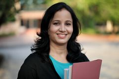 Happy young female student at college campus Royalty Free Stock Image