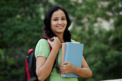 Happy young female student at college campus Stock Images