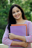 Happy young female student at college campus Stock Photo