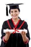 Happy young female student holding diploma Royalty Free Stock Photo