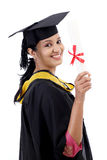 Happy young female student holding diploma Stock Images