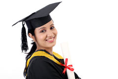 Happy young female student holding diploma Stock Image
