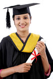 Happy young female student holding diploma Royalty Free Stock Images