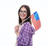 Happy young female student holding US flag Royalty Free Stock Image