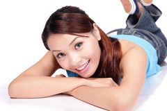 Happy young female student woman lying Royalty Free Stock Photos