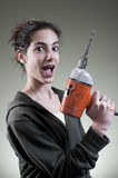 Happy young female working with drill Royalty Free Stock Images